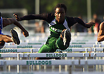 Flagler Palm Coast's Marshwan Gilyard runs in the boys 110 meter high hurdles during the Five Star Conference Track and Field Championships at Flagler Palm Coast's Sal Campanella Memorial Stadium,Thursday, April 8, 2004.(Brian Myrick)