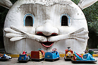 A strange rabbit face is seen over a bumper car arena in Changle Park in Xian, Shaanxi Province, China.