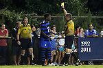19 September 2014: Referee John McCloskey shows the yellow card to Duke's Kevon Black (CAN) (4). The Duke University Blue Devils hosted the University of North Carolina Tar Heels at Koskinen Stadium in Durham, North Carolina in a 2014 NCAA Division I Men's Soccer match. Duke won the game 2-1.