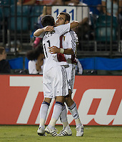Yura Movsisyan, right, celebrates with Javier Morales after scoring his second goal, .during a 3-2 victory by Real Salt Lake in Santa Clara, California, Sept., 27, 2008. Photo by John Todd/isiphotos.com