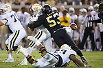 Duke Ejiofor (53) of the Wake Forest Demon Deacons forces a fumble as he hits Georgia Tech Yellow Jackets quarterback TaQuon Marshall (16) during first half action at Bobby Dodd Stadium on October 21, 2017 in Atlanta, Georgia.  The Yellow Jackets defeated the Demon Deacons 38-24. (Brian Westerholt/Sports On Film)