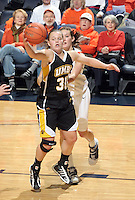 Dec. 18, 2010; Charlottesville, VA, USA; UMBC Retrievers guard Erin Brown (30) grabs the rebound in front of Virginia Cavaliers forward Chelsea Shine (50) during the game at the John Paul Jones Arena. Virginia won 61-46. Mandatory Credit: Andrew Shurtleff-