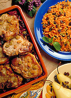 Roasted pork chops, carrot salad and braised pears all topped with raisins.
