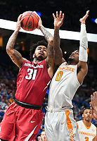 NWA Democrat-Gazette/CHARLIE KAIJO Arkansas Razorbacks guard Anton Beard (31) reaches for a layup as Tennessee Volunteers guard Jordan Bone (0) covers during the Southeastern Conference Men's Basketball Tournament semifinals, Saturday, March 10, 2018 at Scottrade Center in St. Louis, Mo. The Tennessee Volunteers knocked off the Arkansas Razorbacks 84-66