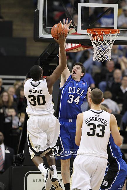 Duke Blue Devils forward Ryan Kelly (34) goes for the block on Wake Forest Demon Deacons forward Travis McKie (30). Duke wins 83-59..