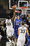 Duke Blue Devils forward Ryan Kelly (34) goes for the block on Wake Forest Demon Deacons forward Travis McKie (30). Duke wins 83-59..