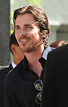 HOLLYWOOD, CA - JULY 07: Christian Bale  attends the Christopher Nolan Hand & Footprint Ceremony At Grauman's Chinese Theatre on July 7, 2012 in Hollywood, California.