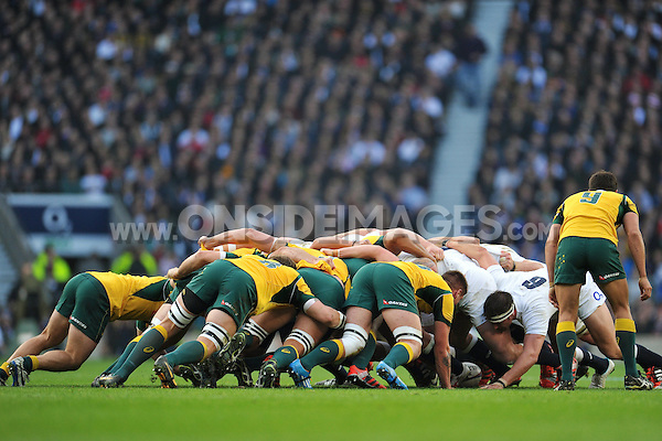 The England and Australia packs engage at a scrum. QBE International match between England and Australia on November 29, 2014 at Twickenham Stadium in London, England. Photo by: Patrick Khachfe / Onside Images