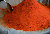 A mound of red chili powder for sale in the markets of Fez, Morocco.
