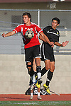Palos Verdes, CA 02/03/12 - unidentified Peninsula player(s) and Hans Seraphim (Palos Verdes #22) in action during the Peninsula vs Palos Verdes boys varsity soccer game.