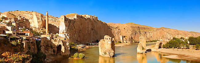 Remains of medieval Artukid Old Tigris Bridge – Built in 1116 by Artukid Fahrettin Karaaslan, the biggest in Anatolia at the time, with the old town Hasankeyf and its ruins on the cliffs abover the river Tigris. The minaret is of the El Rizk Mosque built 1409.  Turkey. 6