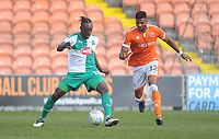 Plymouth Argyle's Freddie Ladapo under pressure from Blackpool's Michael Nottingham<br /> <br /> Photographer Kevin Barnes/CameraSport<br /> <br /> The EFL Sky Bet League One - Blackpool v Plymouth Argyle - Saturday 30th March 2019 - Bloomfield Road - Blackpool<br /> <br /> World Copyright © 2019 CameraSport. All rights reserved. 43 Linden Ave. Countesthorpe. Leicester. England. LE8 5PG - Tel: +44 (0) 116 277 4147 - admin@camerasport.com - www.camerasport.com