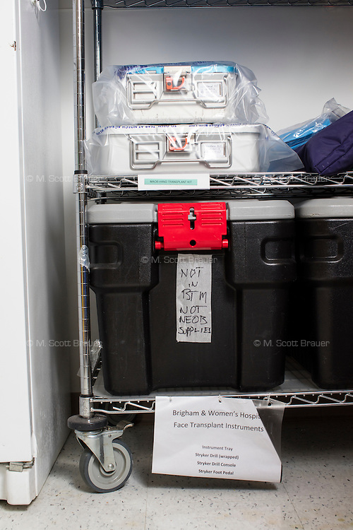 A hand and face transplant kit stands on a shelf in a supply room at the New England Organ Bank, an organ procurement organization based in Waltham, Massachusetts, serving the greater New England area. When a team goes out to receive a donated organ, they will take kits like these that have all of the supplies and instruments used in the process.