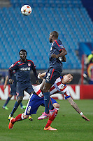 Atletico de Madrid´s Mandzukic (D) and Olympiacos´s Abidal during Champions League soccer match between Atletico de Madrid and Olympiacos at Vicente Calderon stadium in Madrid, Spain. November 26, 2014. (ALTERPHOTOS/Victor Blanco) /NortePhoto