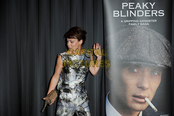 Helen McCrory<br /> The UK premiere of 'Peaky Blinders', BFI Southbank, Waterloo, London, England. 21st August 2013<br /> half length jumpsuit hands arms black white blue pattern grey gray sleeveless profile looking down funny gold clutch bag<br /> CAP/MAR<br /> &copy; Martin Harris/Capital Pictures