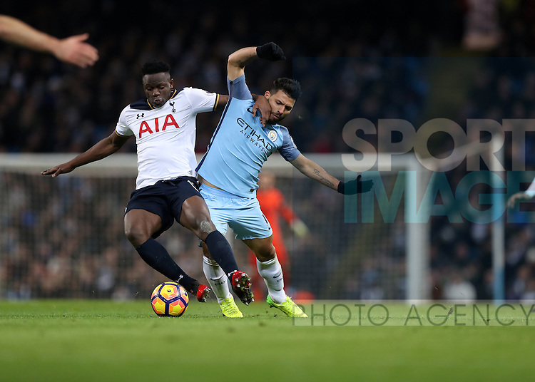 Victor Wanyama of Tottenham Hotspur and Sergio Aguero of Manchester City during the Premier League match at Etihad Stadium, Manchester. Picture date: January 21st, 2017.Photo credit should read: Lynne Cameron/Sportimage