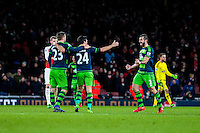 Jordi Amat of Swansea City  ( right ) Celebrates after final whistle at the Barclays Premier League match between Arsenal and Swansea City at the Emirates Stadium, London, UK, Wednesday 02 March 2016