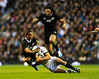 Aaron Cruden of New Zealand looks for support from Ma'a Nonu of New Zealand as he is tackled by Billy Twelvetrees of England during the QBE Autumn International match between England and New Zealand at Twickenham on Saturday 16th November 2013 (Photo by Rob Munro)
