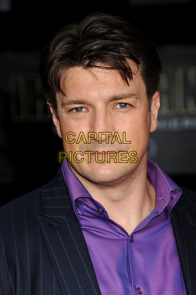 "NATHAN FILLION .""Iron Man 2"" World Premiere held at the El Capitan Theatre, Hollywood, California, USA, 26th April 2010..arrivals portrait headshot  navy blue pinstripe purple shirt .CAP/ADM/BP.©Byron Purvis/AdMedia/Capital Pictures."