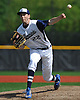 St. Dominic High School starting pitcher No. 22 Kyle Young delivers to the plate in the top of the second inning in Game 2 of the NSCHSAA varsity baseball final against Chaminade at New York Institute of Technology on Monday, May 25, 2015. Chaminade won by a score of 10-0.<br /> <br /> James Escher