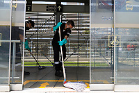 """BOGOTA, COLOMBIA - March 13:  Workers clean a public transportation station of  """"Transmilenio"""" on March 13, 2020 in Bogota, Colombia. The World Health Organization declared a global pandemic as the coronavirus rapidly spreads across the world. Colombian President Ivan Duque declared a health emergency to contain an outbreak of coronavirus, suspending public events with more than 500 people.(Photo by John W. Vizcaino/VIEWpress via Getty Images)"""