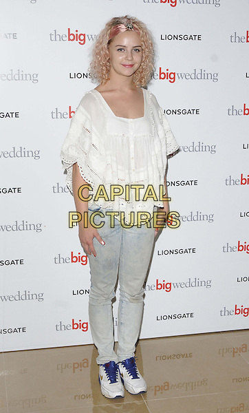 Georgia Henshaw.attended 'The Big Wedding' gala film screening, May Fair Hotel, London, England, UK, 23rd May 2013..full length white broderie anglaise top nike trainers jeans hand on hip .CAP/CAN.©Can Nguyen/Capital Pictures.