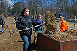 """Washington, CT-031619MK03 Nonnewaug High School students, from the  F.F.A. program (from left) Kennis McCarthy, Aleigah Procaccini and Ryan Parker along with twenty-five classmates, from the  F.F.A. program, volunteer to help with seasonal cleanup and maintenance of the barns and fields at the Humane Organization Representing Suffering Equines (H.O.R.S.E. of Connecticut) Saturday in Washington.  Chris Zanella, a four year volunteer veteran at the farm, said that this was the first of several volunteer days this year at the facility and """"With 23 horses there is always a need for volunteers."""" Marisa Bedron and  Jennifer Jedd, Nonnewaug teachers with the program, said the students were happy to volunteer by assisting with the various needs of the farm and horses, such as grooming, hand walking, cleaning paddocks and barns.  Michael Kabelka / Republican-American"""