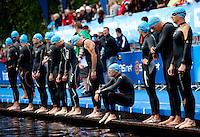 11 JUL 2009 - KITZBUHEL, AUT - Competitors wait for the start of their wave - Jedermann Triathlon (PHOTO (C) NIGEL FARROW)