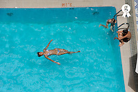 Teenager girl (15) floating in swimming pool (Licence this image exclusively with Getty: http://www.gettyimages.com/detail/83154231 )