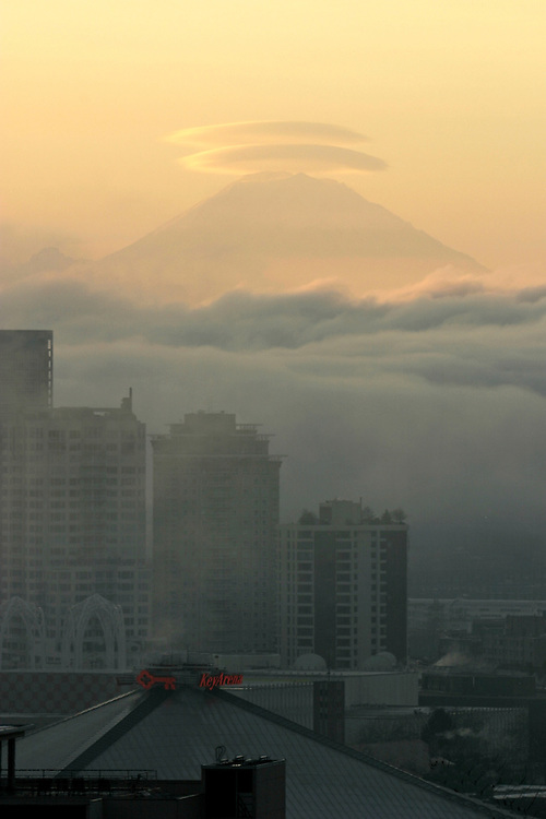Seattle, Mount Rainier, a strato volcano graced with lenticular clouds, sunrise, view south from Queen Anne Hill,