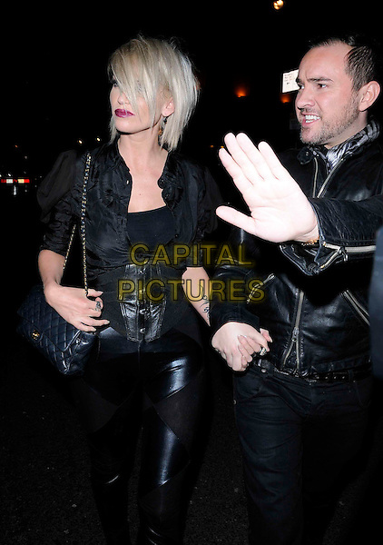 "SARAH HARDING & NICK EDE.The ""Jersey Shore"" launch party at Mahiki, London, England..February 8th, 2011.half length black tattoo leather bag chanel tied up shirt arm purple lipstick make-up holding hands girls aloud trousers .CAP/CAN.©Can Nguyen/Capital Pictures."