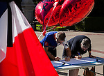 The Alliance Francaise de Sacramento held a vigil for the Nice massacre victims at the California State Capitol on Monday, July 18, 2016.  The Sacramento French Honorary Consul Guy Michelier spoke to the crowd, asked for a moment of silence, followed by singing La Marseillaise the national anthem of France.  People were invited to write their thoughts on poster boards.  The vigil was held for the victims of the Bastille Day, July 14, 2016, attack in France.  Photo/Victoria Sheridan
