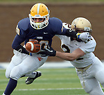 SIOUX FALLS, SD - NOVEMBER 16: Dajon Newell #20 from Augustana looses the football while shaking the grasp of  Jared Twedt #21 from Southwest Minnesota State in the first quarter of their game Saturday at Augustana. (Photo by Dave Eggen/Inertia)