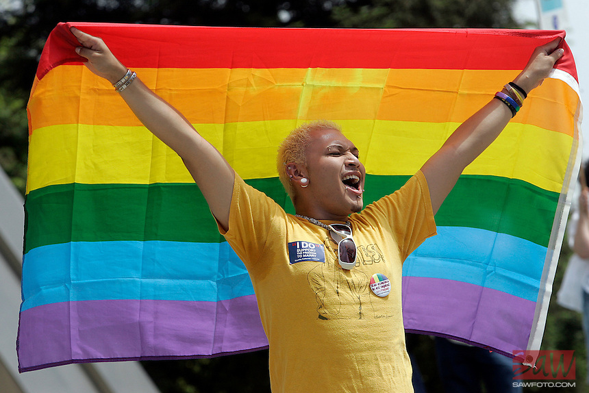 "FRESNO,CA - May 30,2009: Cheering in downtown Fresno, Jess Moreno of Fresno joins other activists representing Gay Rights Movement,  in front of Fresno City hall, may 30, 2009. Gay rights activists are converging on Fresno today for a rally called "" Meet in the middle 4 equality."""