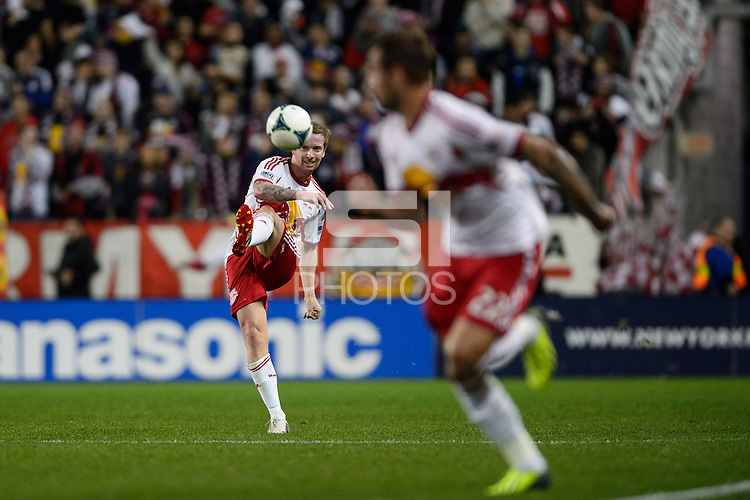 David Carney (8) of the New York Red Bulls passes the ball to Jonny Steele (22). The Houston Dynamo defeated the New York Red Bulls 2-1 (4-3 on aggregate) in overtime of the second leg of the Major League Soccer (MLS) Eastern Conference Semifinals at Red Bull Arena in Harrison, NJ, on November 6, 2013.
