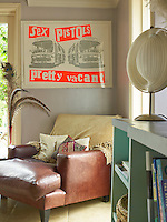 A leather armchair beneath a Sex Pistols' promotional poster occupies a corner of the living room