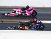 Sep 4, 2017; Clermont, IN, USA; NHRA pro stock motorcycle rider Angie Smith (near) against Jerry Savoie during the US Nationals at Lucas Oil Raceway. Mandatory Credit: Mark J. Rebilas-USA TODAY Sports