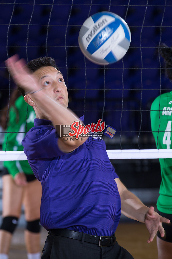 High Point Panthers assistant coach Jake Hong helps his team warm-up prior to their match against the Marshall Thundering Herd at the Panther Invitational at the Millis Athletic Center on September 12, 2015 in High Point, North Carolina.  The Thundering Herd defeated the Panthers 3-2.   (Brian Westerholt/Sports On Film)