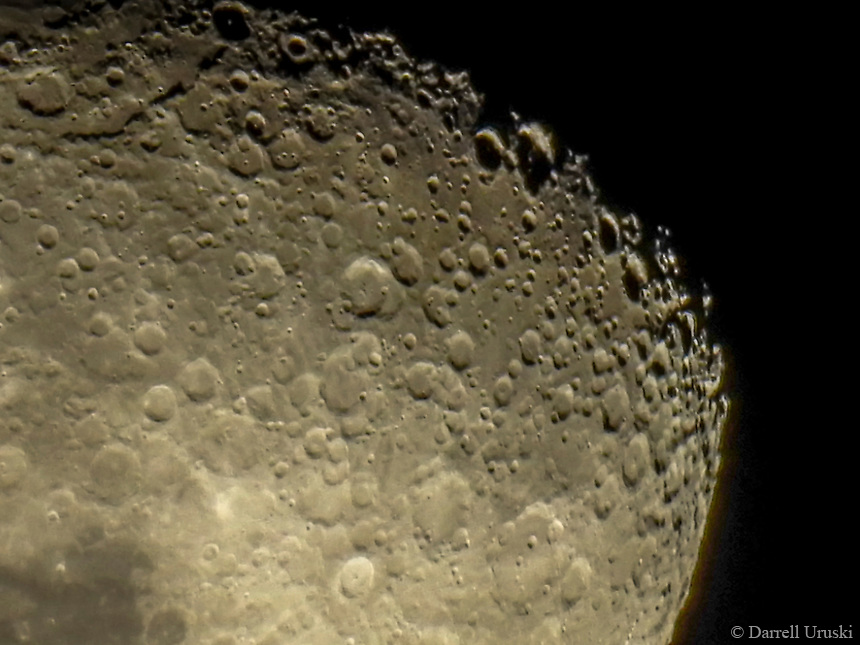 Close up photograph of the moon under the firmament in the sky.