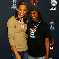 Lolo Jones poses for photo with a fan at the AT&T autograph signing session on Saturday, February 23, 2008  at the Reggie Lewis Center, Roxbury,MA. Photo by Errol Anderson,The Sporting Image.