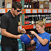 Steven Matz, New York Mets pitcher and Stony Brook native who graduated from Ward Melville High School in 2009, signs a baseball cap for Brendan Jorgensen, 11, of Bohemia, during an appearance at Holbrook Liquors, located at 125 Beacon Drive, on Monday, Aug. 8, 2016.