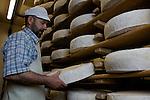 Ramon Caball&eacute; dans sa cave d'affinage pr&eacute;sentant ses tomes de montagne. Fromagerie de la Durance. Guillestre<br /> Ramon Caball&eacute;, cheese maker . Fromagerie de la Durance. Guillestre