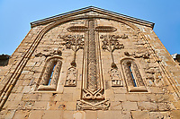 Pictures &amp; images of the Church of the Assumption exterior bas relief Georgian stone work of a crucifix and angel figures,1689, Ananuri castle complex &amp; Georgian Orthodox churches, 17th century, Georgia (country).<br /> <br /> Ananuri castle is situated next to the Military Road overlooking the Aragvi River in Georgia, about 45 miles (72 kilometres) from Tbilisi. It was the castle of the eristavis (Dukes) of Aragvi from the 13th century and was the scene of numerous battles. In 2007 Ananuri castle was enscribed on the   UNESCO World Heritage Site tentative list.<br /> <br /> The exterior of The Church of the Assumption is highly decorated with Georgian bas relief sculpture. Above the main door is a geometric stone relief of a crucifix which is the whole height of the facade. Either side of the crucifix are reliefs of the tree of life below which are reliefs of naive style angels.