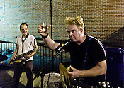 The Wigg Report's Stephen Mullaney give a toast before playing on battery power outside Slim's during the Hopscotch Music Festival, Raleigh, N.C., Friday, Sept. 10, 2010.