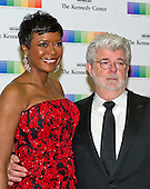 George Lucas and wife, Mellody Hobson, arrive for the formal Artist's Dinner honoring the recipients of the 38th Annual Kennedy Center Honors hosted by United States Secretary of State John F. Kerry at the U.S. Department of State in Washington, D.C. on Saturday, December 5, 2015. The 2015 honorees are: singer-songwriter Carole King, filmmaker George Lucas, actress and singer Rita Moreno, conductor Seiji Ozawa, and actress and Broadway star Cicely Tyson.<br /> Credit: Ron Sachs / Pool via CNP