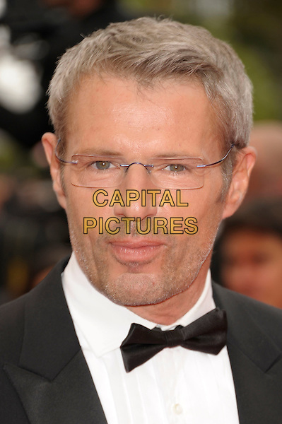 LAMBERT WILSON .Opening Ceremony and 'Midnight In Paris' Premiere at the Palais des Festivals, 64th International Cannes Film Festival, France.11th May 2011.screening arrivals portrait headshot glasse black bow tie tuxedo tux stubble facial hair .CAP/PL.©Phil Loftus/Capital Pictures.
