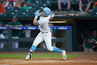 Michael Busch (15) of the North Carolina Tar Heels follows through on his swing against the Miami Hurricanes in the second semifinal of the 2017 ACC Baseball Championship at Louisville Slugger Field on May 27, 2017 in Louisville, Kentucky. The Tar Heels defeated the Hurricanes 12-4. (Brian Westerholt/Four Seam Images)