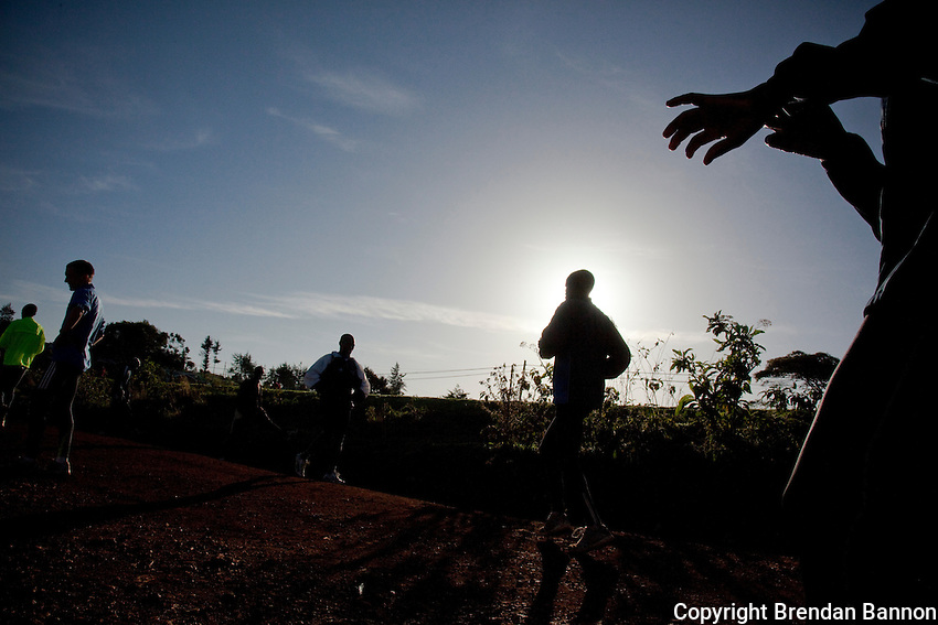 Runners finish a morning run near the main road in Iten, kenya. The high altitude training ground is well known for producing  world champion runners. The Dubai national team trains here as well.
