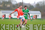 Brosna's Seamus McAuiffe races for the loose ball against Niall Moloney of Blackrock in the Munster Junior B Football final held last Sunday in Knockaderry.