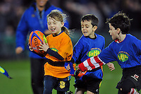 Action from the half-time Jaffa tag rugby. European Rugby Champions Cup match, between Bath Rugby and Wasps on December 19, 2015 at the Recreation Ground in Bath, England. Photo by: Patrick Khachfe / Onside Images